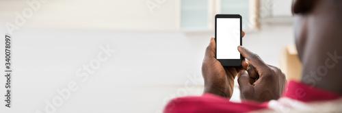 Obraz na plátně African Man Using Cellphone