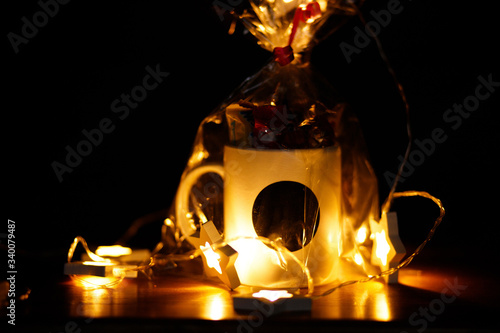 Gift cup filled with sweets in dark warm atmosphere horisontal aspect ratio Canvas Print