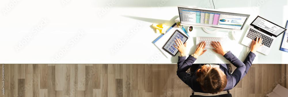 Fototapeta Businesswoman Doing Multitasking Work In Office