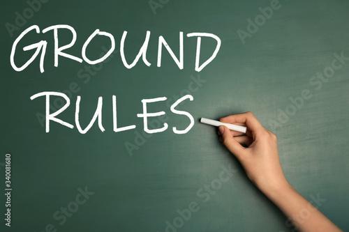 Fotografia, Obraz Woman writing phrase GROUND RULES on chalkboard, closeup