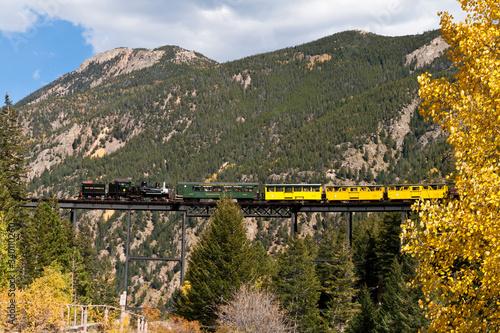 Fototapeta Train On Bridge Against Mountain obraz na płótnie