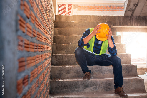 Construction workers sit sad on the job site, there are unemployed, hopeless crisis, low economic crisis, business failure Fototapeta