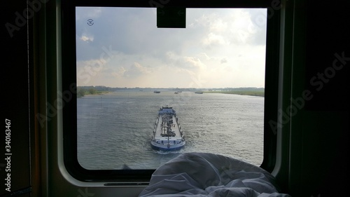 Fotografia Barge Seen Through Ship Window On River