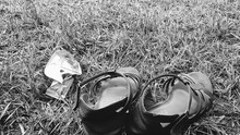 Shoes On Grassy Field