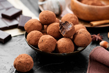 Handmade Chocolate Truffles Covered With Cocoa On Black Background.