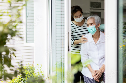 Leinwand Poster Caregiver woman take care of the elderly,depressed senior is waiting for her fam