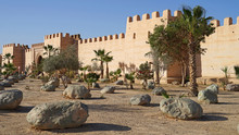 Old Berberian Town Defensive Wall With Gate And Park With Palm Trees, Taroudant, Morocco