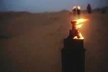 Lit Oil Lamp At Dusk