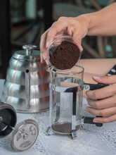 Closeup Preparing Coffee By French Press, Pouring Ground Coffee Into A Glass Jar.