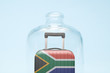 canvas print picture - Luggage in isolation under glass cover covid-19 South africa tourism abstract.