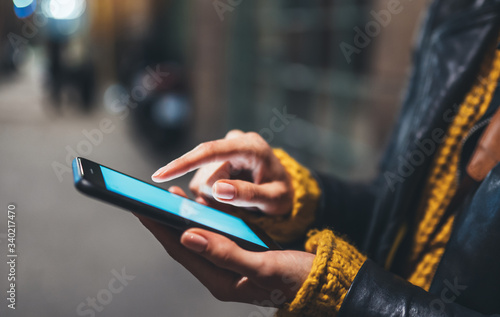 woman texting text message, point finger on screen smartphone light night city, Fototapete