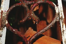 Water Drop On Rusty Heart Shape Railing