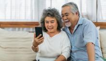 Asian Couple Grandparent Takin...