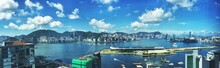 Panoramic View Of Victoria Harbour In City Against Sky