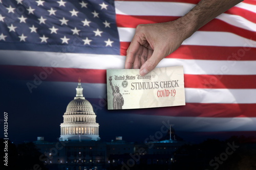Foto Man with Stimulus check and the Capitol and US flag on the Background