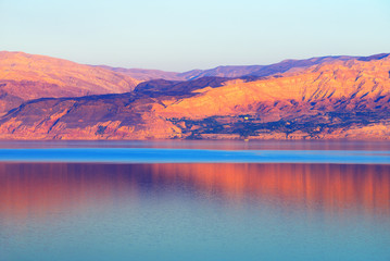 Dead Sea and mountains at sunset time
