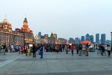 People On Bund By Shanghai Customs House At Dusk