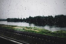 Raindrops On Train Window Of Rainy Season