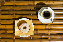 Donut And Coffee On Wooden Bam...