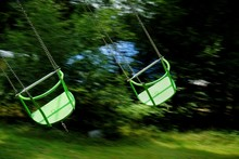 Close-up Of Moving Swings