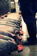 Low Section Of Man Standing By Tuna Fish For Sale At Market