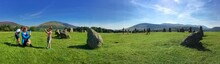 Boy Photographing Mother And Brother At Castlerigg Stone Circle