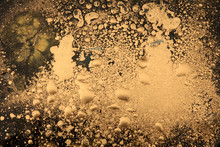 Macro Black And Gold Abstract Bubble Drop Texture Background. Acrylic Color In Water And Oil.