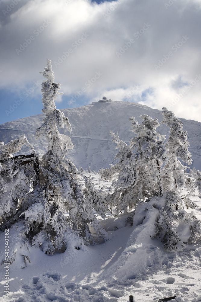KARPACZ, POLAND - MARCH 08, 2020: Snezka or Sniezka (in Czech and Polish) is a mountain on the border between the Czech Republic and Poland. Winter landscape. Giant Mountains, Poland, Europe.