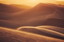 Sand Dunes In Desert Landscape At Sunset