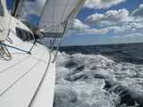 Low Angle View Of Boats Sailing In Sea