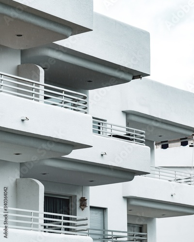 Vertical shot of the white building with several balconies Wallpaper Mural