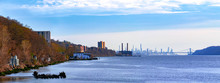 Waterfront View In Hastings-On-Hudson, NY, With The Hudson River And New York City In The Background