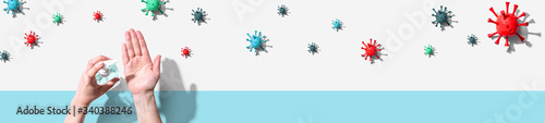 Obraz Applying sanitizer gel - healthcare and hygiene concept - fototapety do salonu