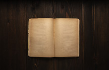 Vintage Book, Open, On Old Wooden Table, With Clipping Path. Open Book Blank On Old Wooden Background. Book With Blank Pages