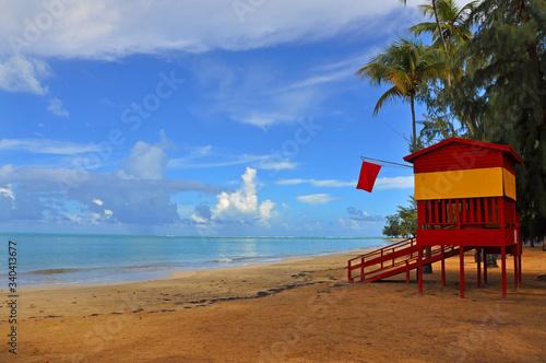 Fotografie, Obraz Lifeguard Hut On Beach Against Sky