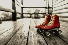 Close-up Of Roller Skates On Floorboard