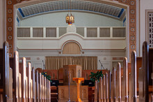 Medium Wide Shot Of An Empty Church Sanctuary With Afternoon Sunlight Pouring In Creating Shadows Down The Aisle To The Front Of The Church