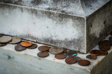 Old Tradition Of Various American Coins Lying On Gravestone As Sign Of Respect
