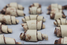 Rugelech - Yeast Dough Cookies Filled With Cocoa And Sugar Arranged On Baking Paper, Handmade.