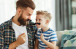 Leinwandbild Motiv Father's day. Happy funny family son and dad with mustache .