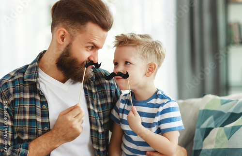 Photo Father's day. Happy funny family son and dad with mustache .