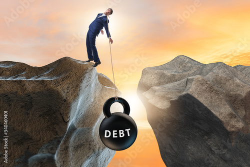 Fototapeta Concept of debt and load with businessman obraz