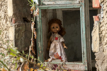 Abandoned Doll In Old Building