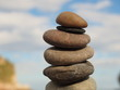 Close-up Of Stone Stack On Rock Against Sky