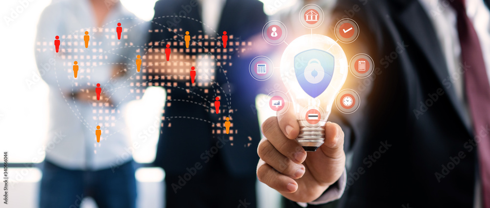 Fototapeta Innovation and idea of professional leader holding lighting bulb, business people planing and analysis work on table in office, brainstorming teamwork and thinking management, protect business concept