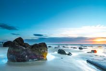 Moeraki Boulders At Koekohe Beach Against Sky During Sunset