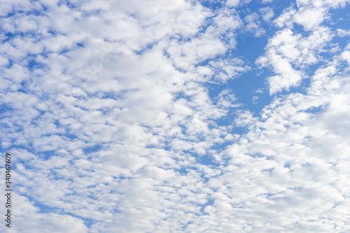 Photo Cloudscape with altocumulus clouds, Altocumulus middle-altitude cloud in stratoc