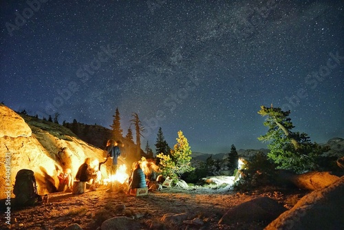 Canvas Print People Camping On Mountain Against Star Field