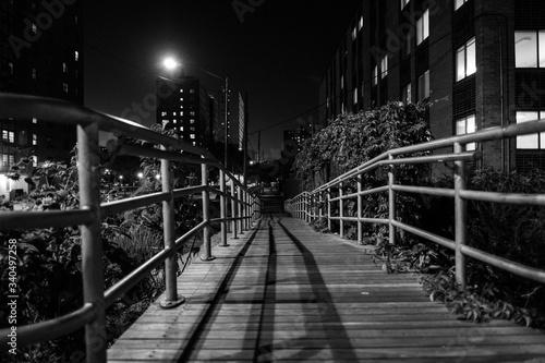 Footbridge In City At Night Wallpaper Mural