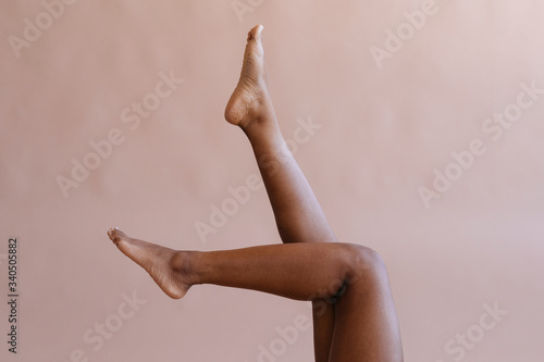 Photo Tanned legs in the air